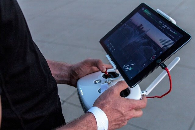 person-controlling-drone