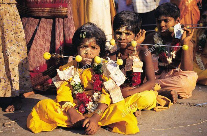 children with pierced metal rods mariamman festival tamil nadu india FJ8GM4 e1533551371771