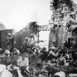 French troopers under General Gouraud driving back Germans with their machine guns amongst the ruins of a cathedral near the Marne