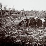 An archive picture shows soldiers and horses amid a destroyed spot on the battlefield at Maurepas on the Somme front, northern France